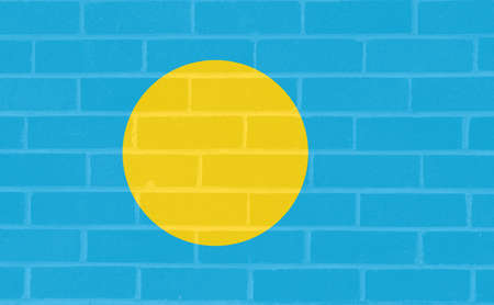 brickwall: Illustration of the national flag of  Palau looking like it has been painted onto a brickwall. Stock Photo