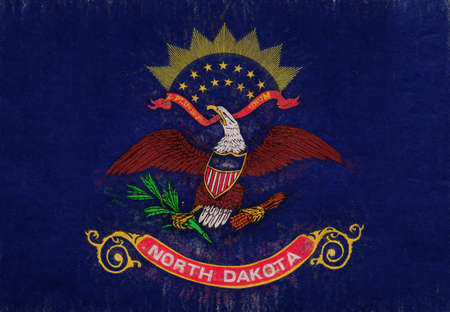Illustration of the flag of North Dakota state in America with a grunge look.