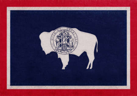 Illustration of the flag of Wyoming state in America with a grunge look.