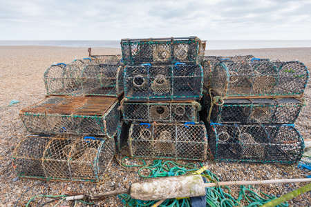 commercial fishing: Stack of Lobster Pots on a beach ready for use.
