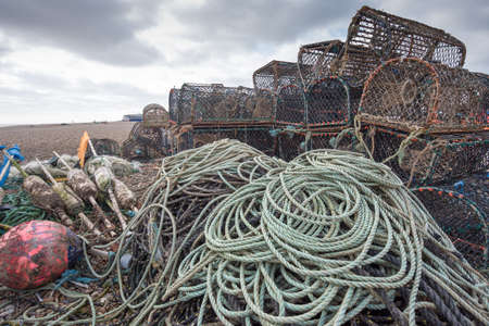 Lobster pots with ropes and floats on a beach