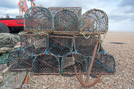 Lobster Pots and a boat on a beach ready to use.
