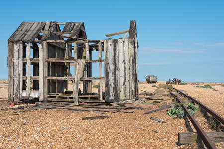 Old fishing boat and shed falling to pieces Stock Photo