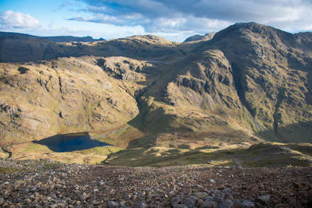 High view of Styhead Tarn  located in the Lake District National Park in the County of Cumbria,North West England,UK. Stok Fotoğraf