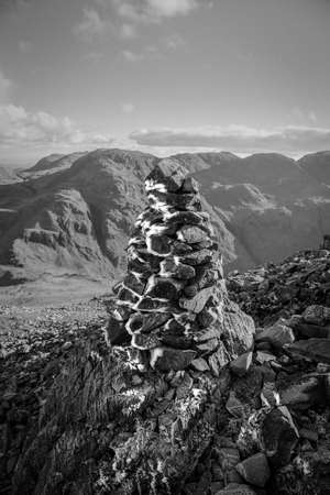 Black and White image of a  ice and frost covered Cairn   located on a Fell in the Lake District National Park in the County of Cumbria,North West Banco de Imagens