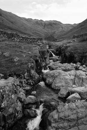 Black and White image of a small stream located in the Lake District National Park in the County of Cumbria,North West England,UK. Banco de Imagens