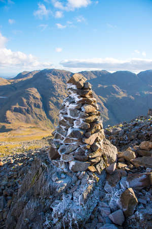 The frost covered Cairn is located on a Fell in the Lake District National Park in the County of Cumbria,North West England,UK.