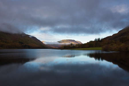 Dawn breaking on Crummock Water in the Lake District National Park in the County of Cumbria,North West England,UK.
