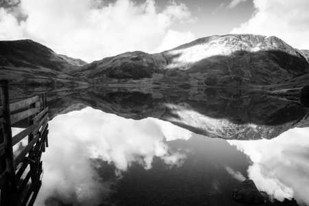 Black and White photograph of dawn on Crummock Water. Crummock Water is located in the Lake District National Park in the County of Cumbria,North West England,UK.