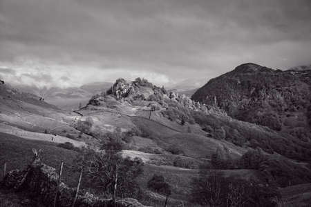 The Black and White image of two crags Castle Crag and Raven Crag are located in the North Western Fells of the English Lake District National Park.