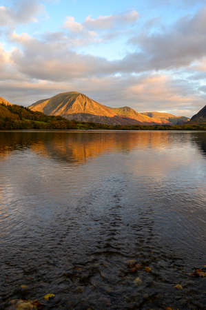 The sun is setting on Grasmoor fell viewd from Loweswater in The Lake District,Cumbria,UK. Reklamní fotografie