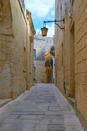 View of one of the many ancient narrow medieval streets in the  town of Mdina, Malta