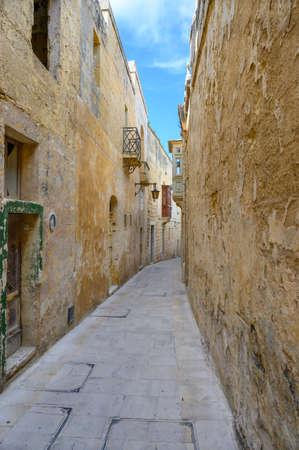 Narrow street in the ancient Maltese city of Mdina on the island of Malta.