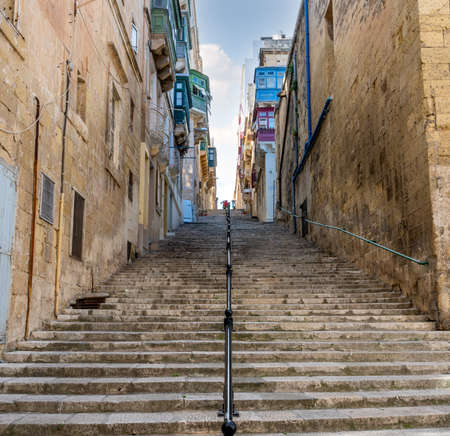 Flight of old stone steps in Valletta the capital of the Island of Malta.