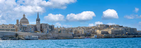 Panoramaof Valletta from the seafront showing the dome of the Basilica of Our Lady of Mount Carmel and St Paul's Pro-Cathedral. Stock fotó