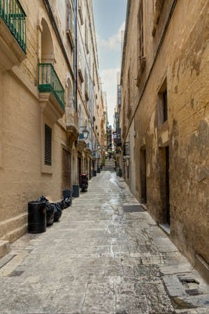 Narrow street leading to some steps in Valletta the capital city of Malta.