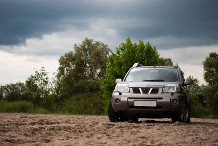 offroad: The silvery car costs on sand Stock Photo