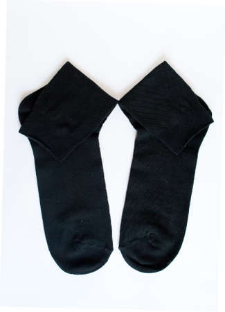 Black socks on the white background Stock Photo