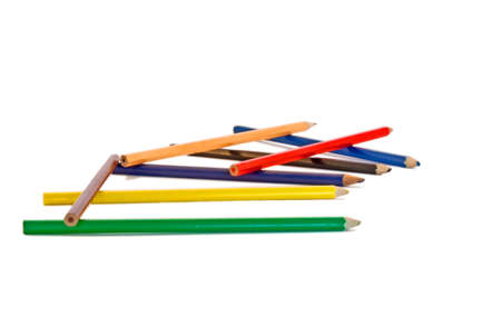 Pencils scattered on a white background.