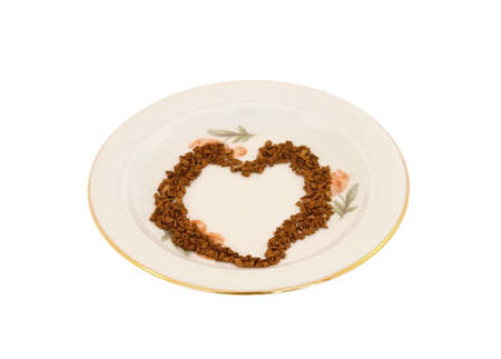 Heart laid out from coffee on a white background
