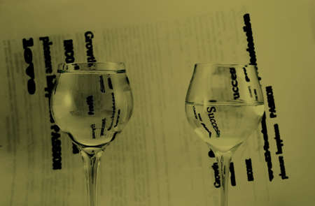 Two glasses with water, black and white background. Stock Photo