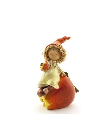 The boy sits on an apple on a white background Stock Photo