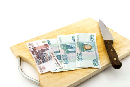 Money, knife for a board for are sharp on a white background.
