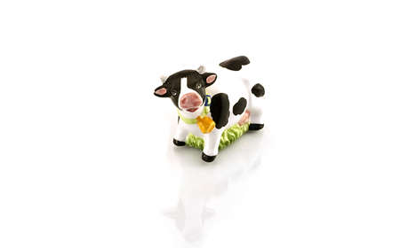 Figurine of a cow on a white background
