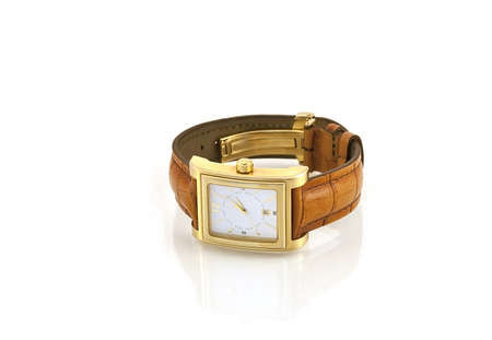 Golden watch with leather strap on a white background