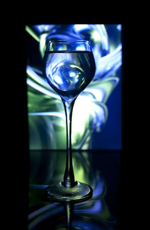 Glass cup on a colored background
