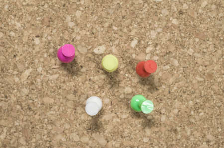 cork board: colored pins on a corkboard