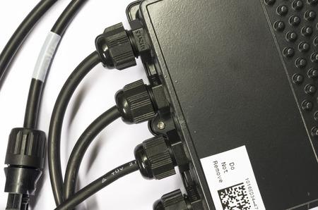 photoelectric: solar panel power optimizer close up, white background