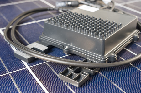 the optimizer: solaredge, solar panel power optimizer close up, solar cells background Editorial