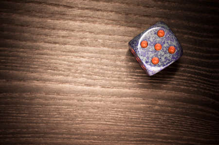 luckiness: dice on a wooden surface, five Stock Photo