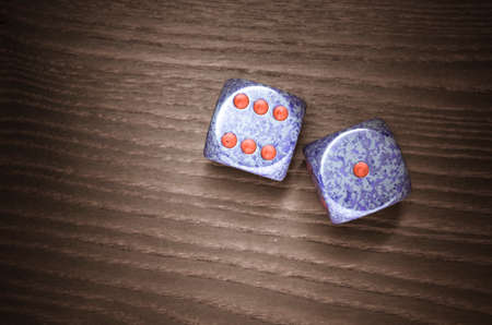 luckiness: dices on a wooden surface, six one