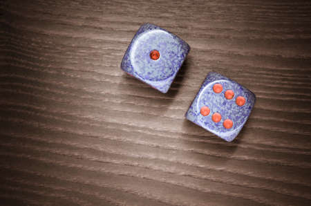 luckiness: dices on a wooden surface, one six Stock Photo