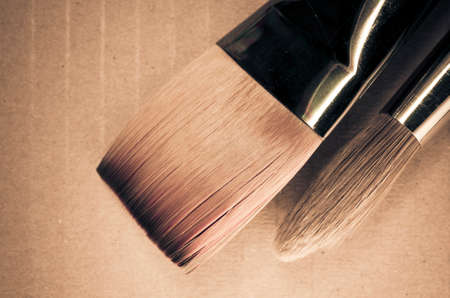 bristle: paintbrushes bristle close up on a cardboard Stock Photo