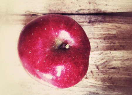surface: Red ripe apple on a wood surface