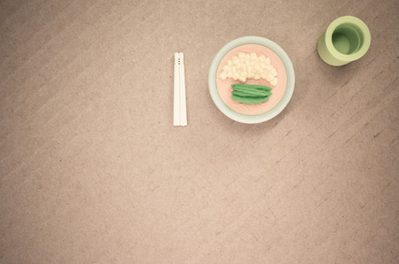 paperboard: miniature foods on a paperboard surface