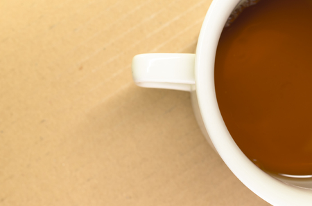 caffeine free: tea in a white porcelain cup on a paperboard surface