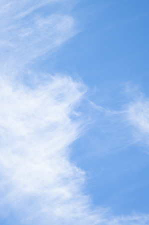faint: blue sky with scattered faint clouds Stock Photo