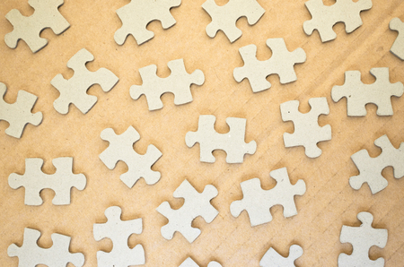 dovetail: jigsaw puzzle pieces on a paperboard surface