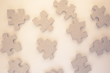 dovetail: jigsaw puzzle pieces on a matt glass surface