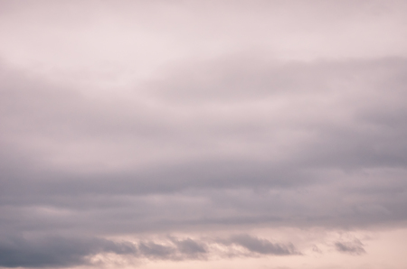 thick: abstract background - thick heavy scattered gray clouds at sunset Stock Photo