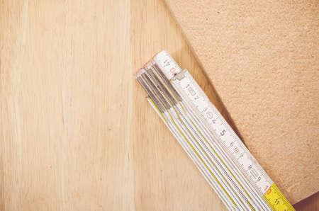 yardstick: thermal insulating compressed hemp fiber panel and yardstick - natural wood background Stock Photo