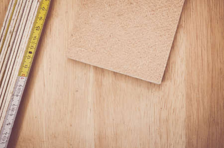 compressed: thermal insulating compressed hemp fiber panel and yardstick - natural wood background Stock Photo