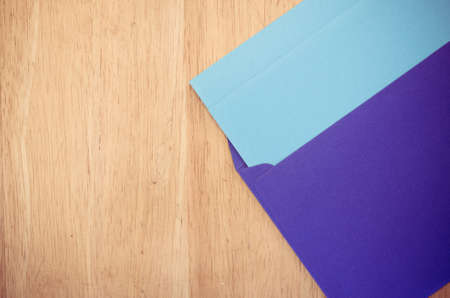 dopisní papír: dark blue envelope and blue writing paper on a natural wood surface