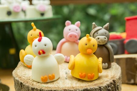 Kids Party Decoration - Farm Theme. Shaped candy personalized. Cake table detail. Handmade sweets with great care. Childhood and joy concept. Copy space Selective focus. Banco de Imagens