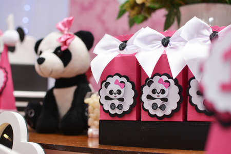 Girl birthday party decoration detail Panda theme. Wonderful sweets, cupcakes, cake, boxes and designs. 1 year old birthday. Cute girl party decoration.Selective focus. Imagens