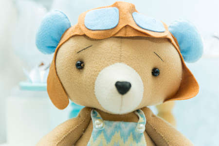 Teddy bear with aviator hat and glasses. handsome Bear with glasses and vintage airplane pilot helmet. Selective focus.